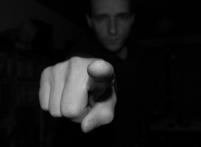 Finger pointing at camera