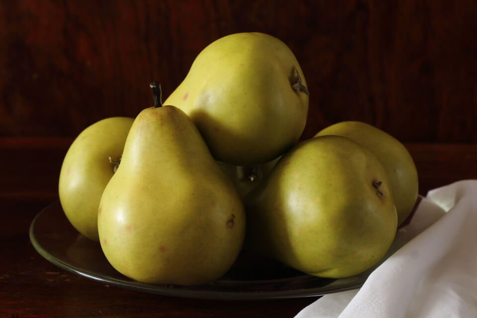 Green pears on a plate